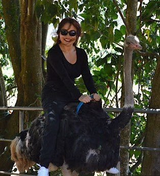 The Travel Ninjas riding an ostrich at the Prenn Waterfalls in Dalat, Vietnam