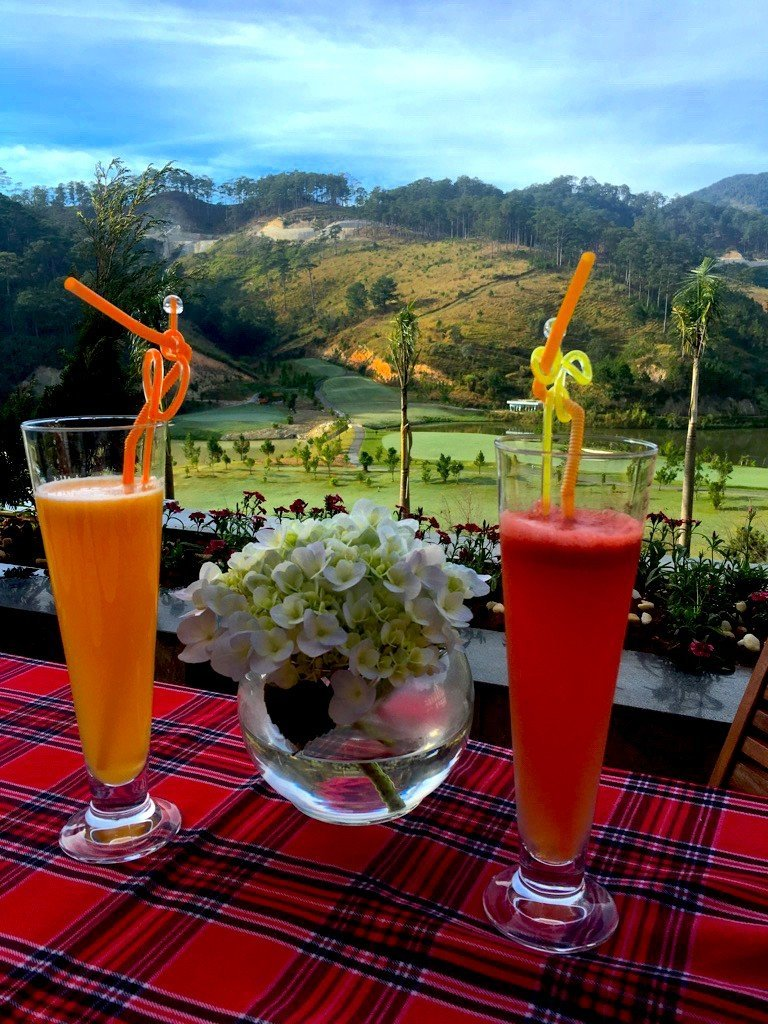 The Travel Ninjas enjoying some drinks and a great view at the Swiss Belresort in Dalat, Vietnam