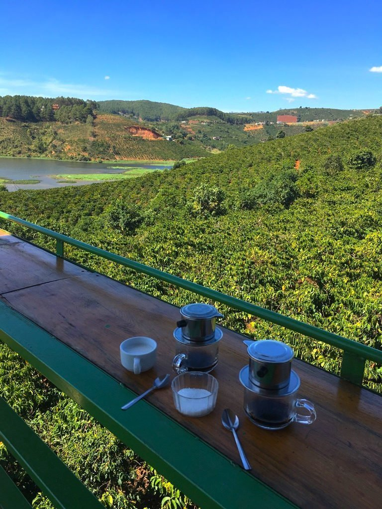 The Travel Ninjas enjoying Weasel Coffee and a Beautiful View in Dalat, Vietnam