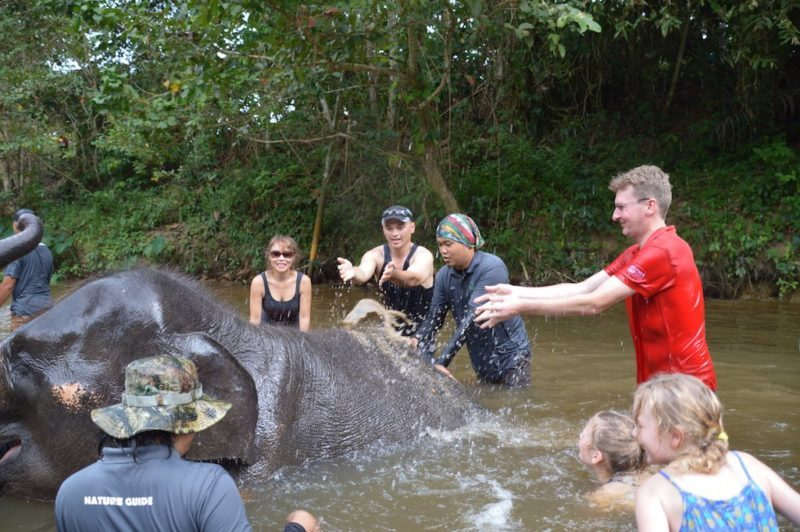 Vanessa and Steve, The Travel Ninjas, bathing a baby Asian Elephant
