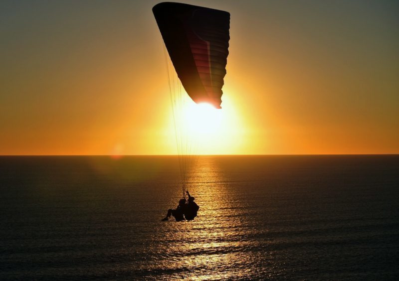 Paragliding at Sunset off Timbis Hill - Adventurous Things to do in Bali # 7