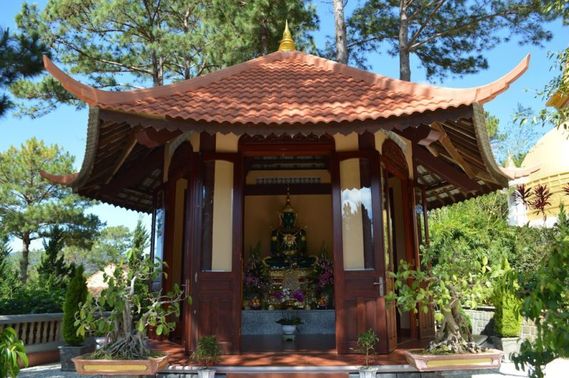 A Small Outdoor Altar and Beautiful Jade Buddha in Truc Lam Monastery in Dalat, Vietnam. Central Vietnam in Southeast Asia.