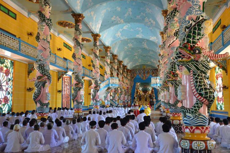 Things to do in Ho Chi Minh. Cao Dai Worship at the temple near Saigon Vietnam