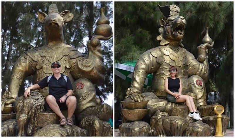 Us Sitting On Our Zodiac Animals – Rat and Tiger at Suoi Tien in Ho Chi Minh City Vietnam Saigon